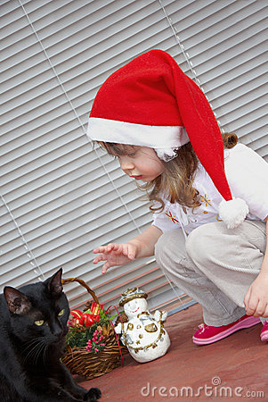 Little girl and black cat