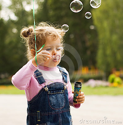 Little girl blow bubbles