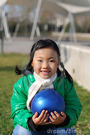 Little girl and blue ball