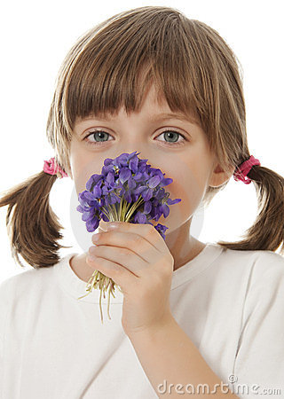 Little girl with a bouquet of violets