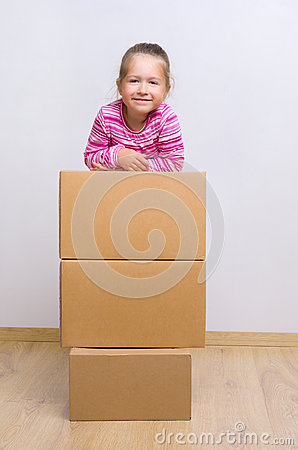 Little girl with boxes