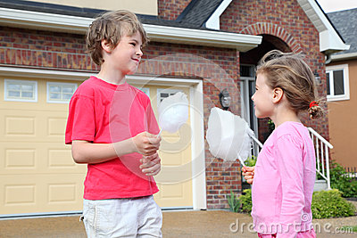 Little girl and boy with cotton candy