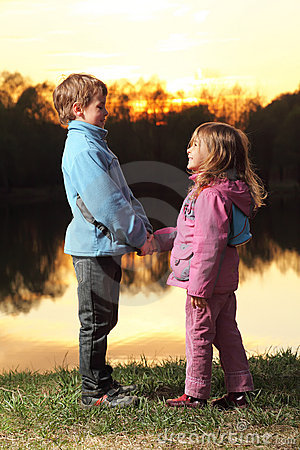 Little girl and boy looking to each other