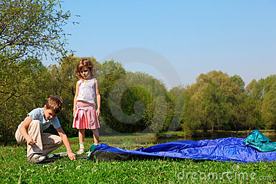 Little girl and boy making tent