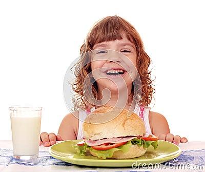 Little girl with breakfast