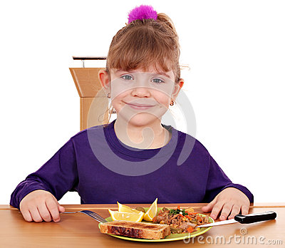 Little girl with breakfast