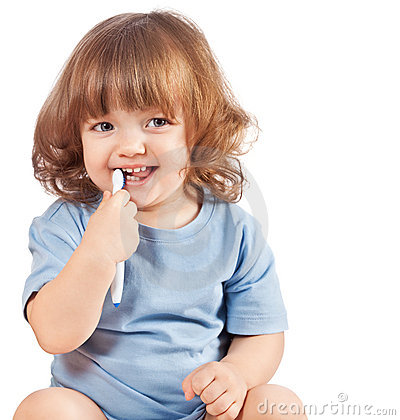 Little girl brushes her teeth, isolated