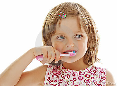Little girl brushing teeth isolated