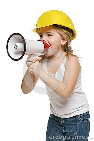 Little girl builder in yellow helmet screaming into the loudspeaker