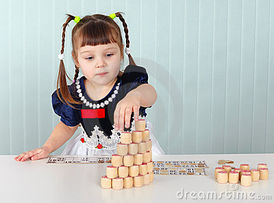 Little girl builds tower of lotto