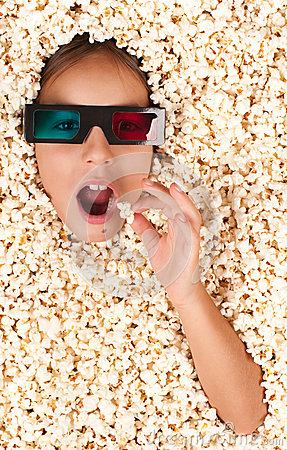 Free Little Girl Buried In Popcorn Stock Photo - 31539780