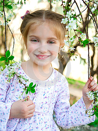 Little girl with bush blossoming