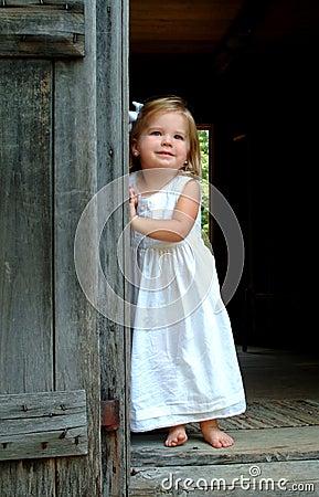 Little Girl in Cabin Doorway