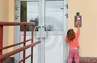 Little girl calling in on-door speakerphone