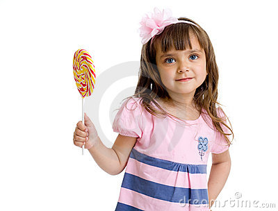 Little girl with candy in studio isolated