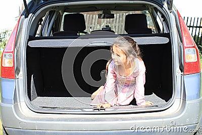 Little girl in car trunk