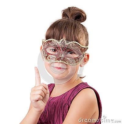 Little girl in a carnival mask