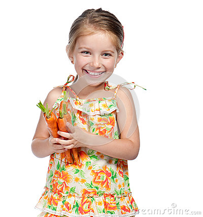 Little Girl  With The Carrot Stock Photo - Image: 25115230
