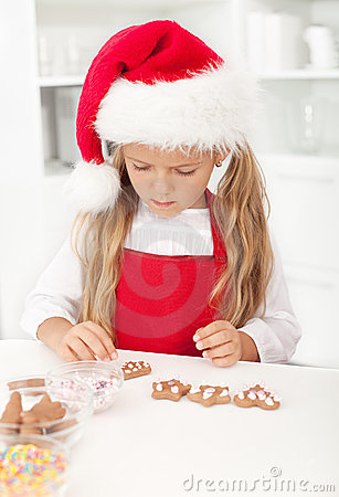 Little girl with christmas cookies