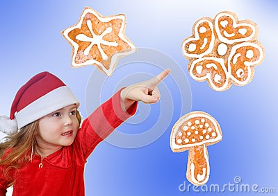 Little girl in Christmas hat pointing