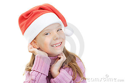 Little girl in Christmas hat smiles