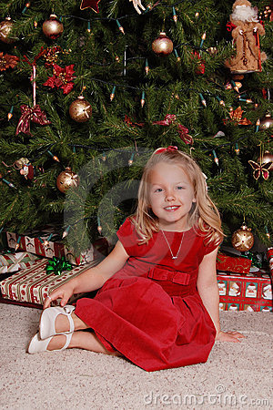 Little girl by Christmas tree.