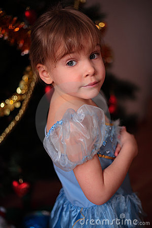 Little girl at christmas tree