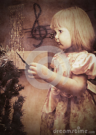 Little girl with Christmas tree