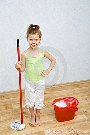 Little girl cleaning the floor