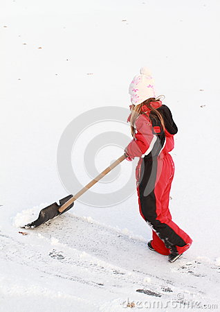 Little girl cleaning ice from snow