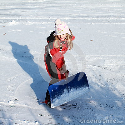 Little girl cleaning ice from snow on pond