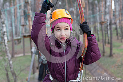 Little girl climber is ready to the passage
