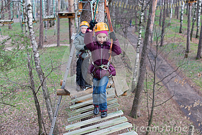 Little girl climber start the passage ropes course