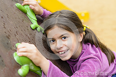 Little Girl on a Climbing Wall