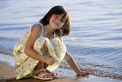 Little girl on coast of sea