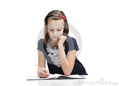 Little girl concentrates on the task