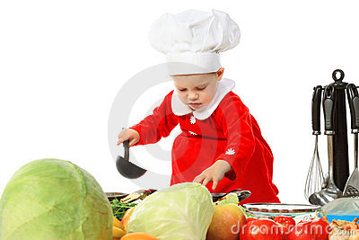 Little girl in a cook cap