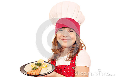 Little girl cook hold dish with salmon seafood
