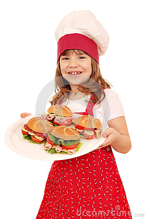 Little girl cook hold plate with sandwiches