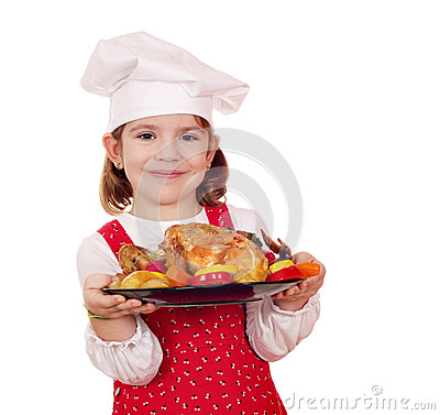 Little girl cook holding chicken