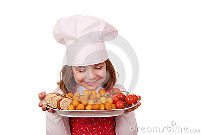Little girl cook smell food