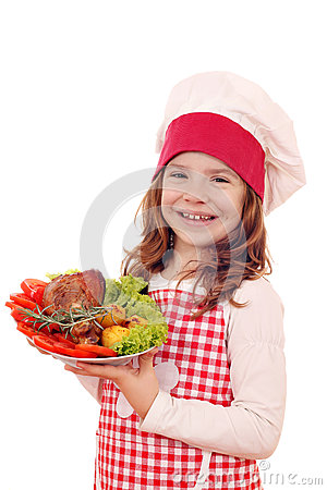 Little girl cook with turkey drumstick Stock Photo
