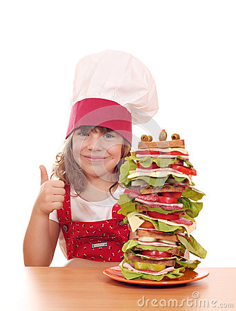 Free Little Girl Cook With Sandwich And Thumb Up Stock Photo - 34294360