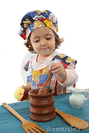 Free Little Girl Cooking Dressed As A Chef Stock Photography - 763212