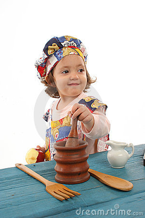 Free Little Girl Cooking Dressed As A Chef Stock Images - 779624