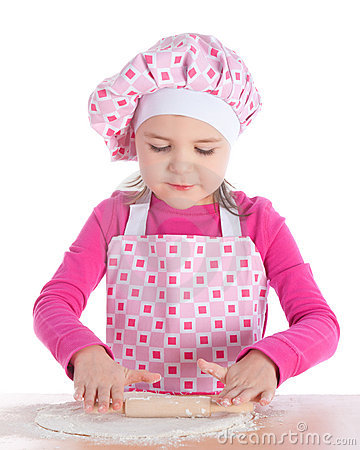 Little girl cooking pizza