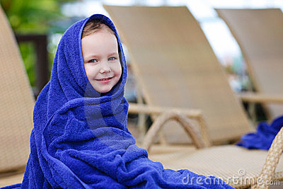 Little girl covered with towel