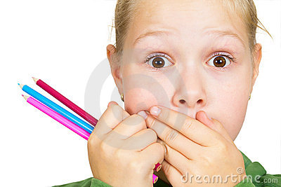 Little girl covers her mouth with her hands
