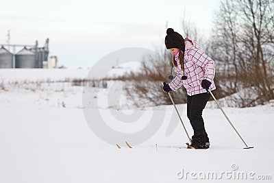 Little girl cross-country skiing
