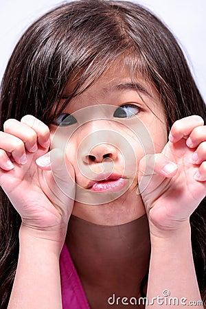 Little girl crossing eyes